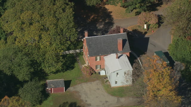 aerial two story historical residence with fall foliage at a bend in the road / deerfield, massachusetts, united states - deerfield massachusetts stock videos & royalty-free footage