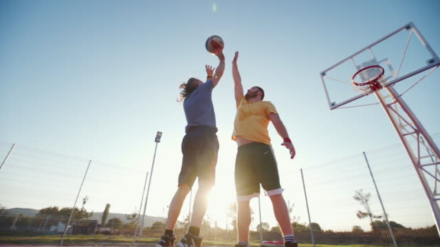 two street basketball players on court - basketball sport stock videos & royalty-free footage