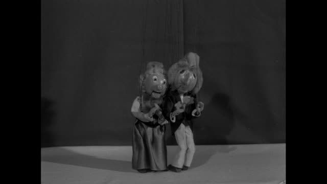 two string puppets dance; 1956 - puppentheater figur stock-videos und b-roll-filmmaterial
