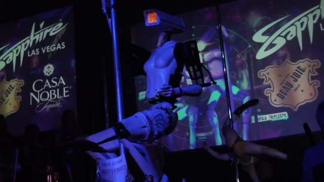 Two 'stripper robots' perform alongside with a pole dancer during a debut of the first robotic erotic dancers in the world at Sapphire Las Vegas...
