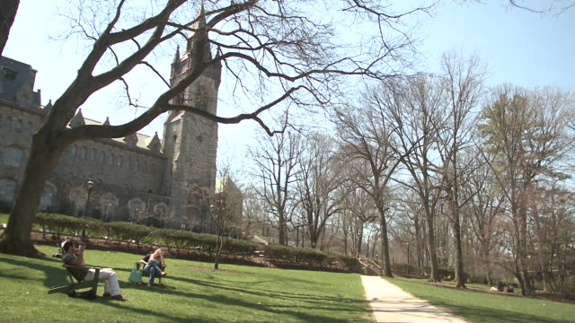 ws two students sitting on deck chairs on campus lawn, bethlehem, pennsylvania, usa - see other clips from this shoot 1503 stock videos and b-roll footage
