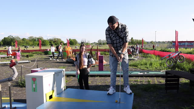 two students, who said they did not mind being photographed, play miniature golf at tempelhofer feld public park during the coronavirus pandemic on... - sporting term stock videos & royalty-free footage