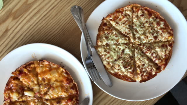 Two style thin crispy pizza in cafe , Bangkok , Thailand.
