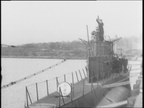 two submarines one on either side of dock / ceremony for older submarines being part of lend lease act and shifted to british and polish navies /... - 賃貸契約点の映像素材/bロール