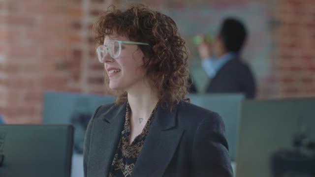 cu two successful businesswomen socialize as they take a break from work - formal businesswear stock videos & royalty-free footage