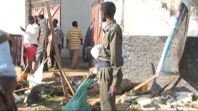 two suicide bombers attacked a restaurant in somalia's capital mogadishu on saturday wounding several people police said, and killing one victim... - witness stock videos & royalty-free footage