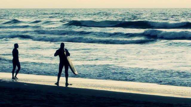Two Surfers at Ocean Beach, San Francisco, California