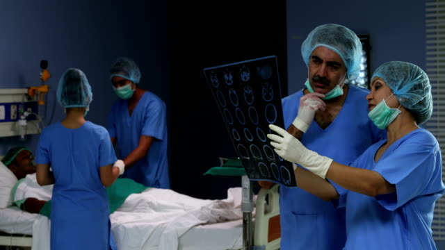 two surgeons discussing a ultrasound scan in hospital , delhi, india - produced segment stock videos & royalty-free footage