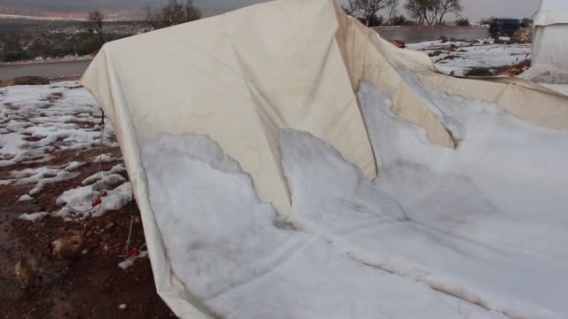 Two Syrian children died after at least 70 makeshift tents collapsed due to heavy snow at Harim region northwestern of Idlib Syria on December 23...