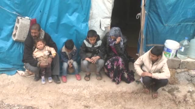 Two Syrian families fled their hometown Hama Syria due to the civil war in their country live in 5 square meter hovels with 18 family members during...
