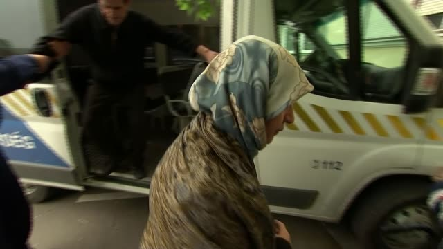 two syrian refugees on trial for threats to hungary's security; hungary: szeged: ext faisal hamad being carried in wheelchair by police officers from... - セゲド点の映像素材/bロール