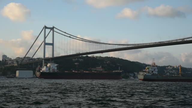 two tankers passing under the bosphorus bridge - bosphorus stock videos & royalty-free footage