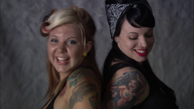 cu, td, tu, two tattooed women dancing standing back to back in studio - see other clips from this shoot 1403 stock videos and b-roll footage