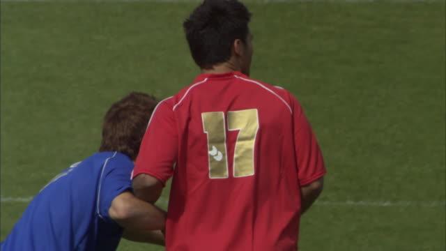 ha ms pan two teams playing soccer on field / sheffield, england, uk - snabb panorering bildbanksvideor och videomaterial från bakom kulisserna