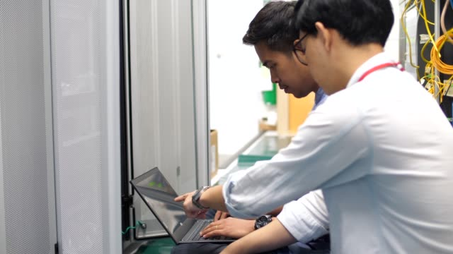 two technicians in the server room - server room stock videos & royalty-free footage