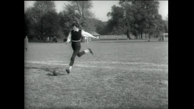 two teddy boys play football together; 1955 - 1955 stock videos & royalty-free footage