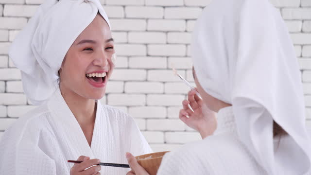 two teenage asian girls happily have a spa session inside their home, women, beauty, confidence, only women, perfection, skin care, spa. - only teenage girls stock videos & royalty-free footage