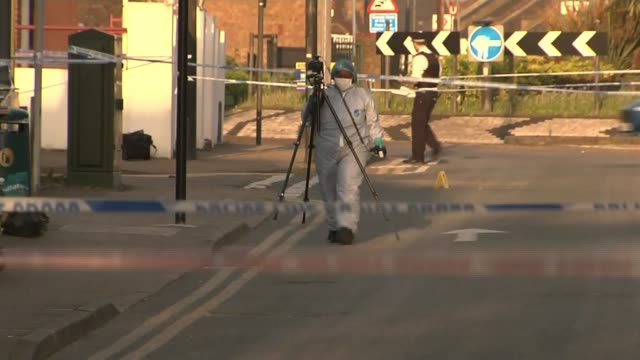 two teenage boys aged 15 and 13 shot in north west london england london harrow wealdstone ext hooded top on pavement various of police and forensic... - harrow stock videos & royalty-free footage