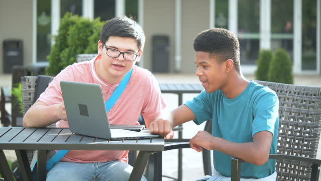 two teenage boys in high school using laptop outdoors - 16 17 years stock videos & royalty-free footage