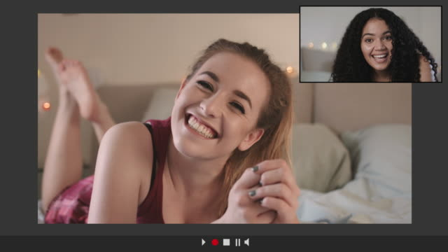 two teenage friends having video call at home from bedroom - long stock videos & royalty-free footage