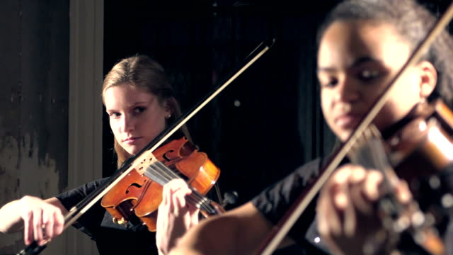 two teenage girls playing violin in concert - classical stock videos & royalty-free footage