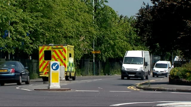 two teenagers killed in romford car crash; england: london: romford: ext 'crow lane' road sign vehicles including ambulance along road post with... - directional sign stock videos & royalty-free footage