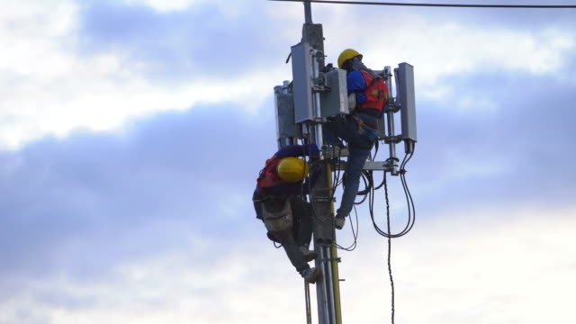 two telecommunication in high altitude works - repeater tower stock videos and b-roll footage