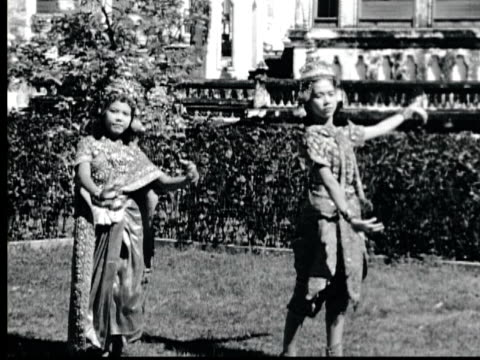 1948 b/w montage two thai young women in elaborate costumes and  headdresses perform slow ritual dance. / bango, thailand - 1976 stock videos and b-roll footage