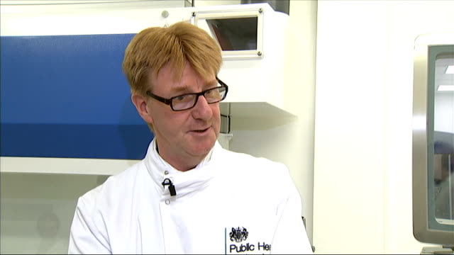 two thirds of shopbought chickens could contain food poisoning bug london john harris talking to reporter in food testing laboratory john harris... - health food shop stock videos and b-roll footage