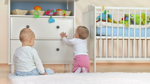 hd: two toddlers exploring nursery room - drawer stock videos & royalty-free footage