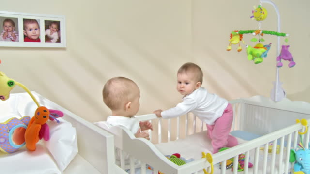 HD: Two Toddlers Exploring The Crib