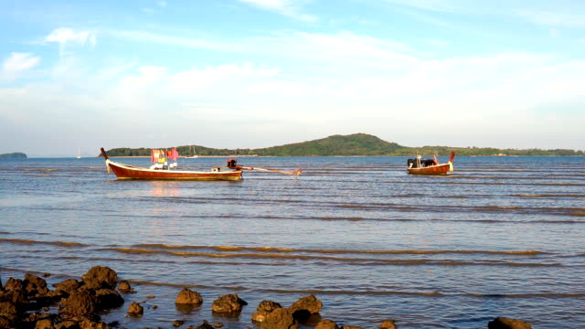 two traditional longtail boats, ko lanta, krabi, thailand - ko lanta stock videos & royalty-free footage