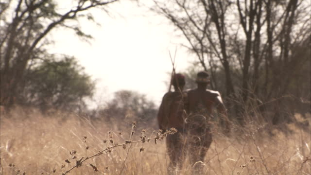 two tribesmen run through the bush. available in hd - hunting stock videos & royalty-free footage