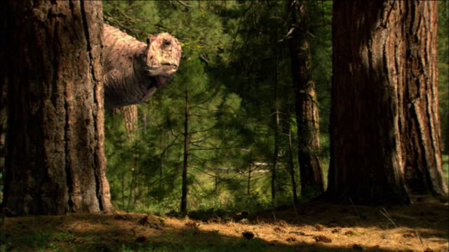 CGI, MS, Two Tyrannosaurus rexes with babies walking through forest