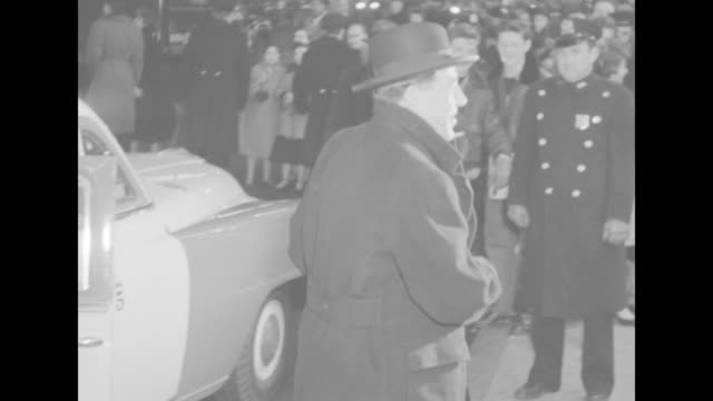 Two unidentified men in hats get out of cab at NYC premiere of The Eddie Cantor Story