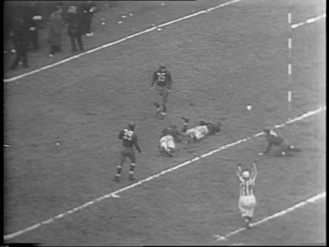 two uniformed canadian soldiers standing and cheering / chicago back sid luckman passes the ball to chicago back harry clark / clark scores game... - nfc east stock videos & royalty-free footage