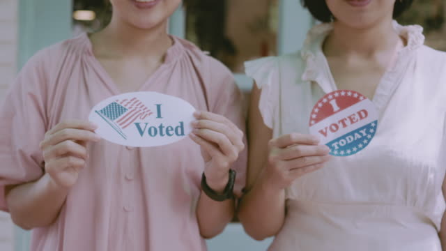 "two unrecognizible women showing off their ""i voted"" sticker - voting rights stock videos & royalty-free footage"