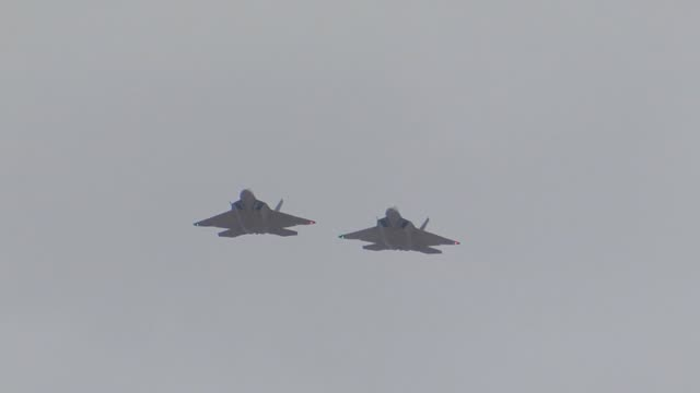 two us air force f22 raptors assigned to the 27th fighter squadron joint base langleyeustis va pass overhead on approach to nellis during red flag... - stealth stock videos and b-roll footage