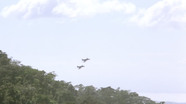 two u.s. air force f-4 fighter jets fly over the treetops of the vietnam jungle. - us airforce stock videos & royalty-free footage