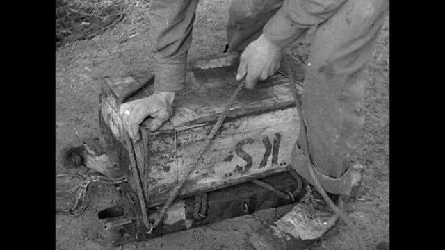 vs two us army soldiers taking field ration 'ks' boxes from beach stack mounting to brace vs soldiers carrying k rations 'backpack' up muddy hill... - 1940 stock videos & royalty-free footage
