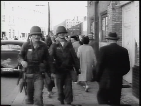 b/w 1961 two us soldiers walking on busy city sidewalk / berlin germany / newsreel - 1961 stock-videos und b-roll-filmmaterial