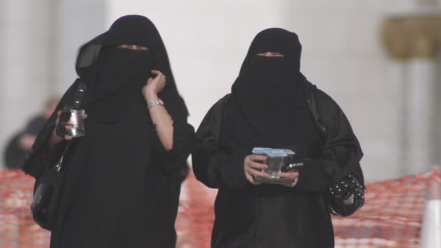 ms pan two veiled women in conversation / abu dhabi, united arab emirates - hijab stock videos and b-roll footage