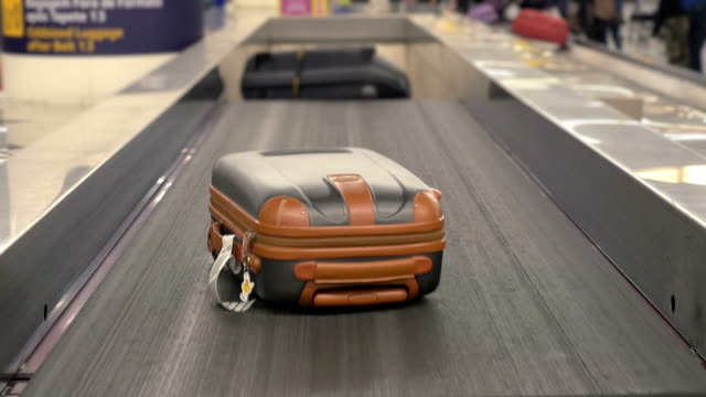 two videos of baggage carousel in 4k - baggage claim stock videos and b-roll footage