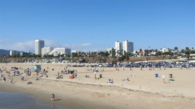 two videos of beach in santa monica in 4k - sunbathing stock videos & royalty-free footage