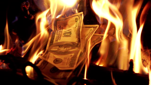 two videos of burning money in real slow motion - burning stock videos & royalty-free footage