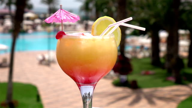two videos of cocktail by the pool -real slow motion - tropical drink stock videos & royalty-free footage