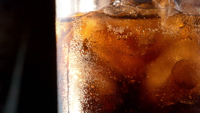 Two videos of cold cola in 4K