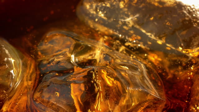 two videos of cold cola with ice cubes in 4k - close up stock videos & royalty-free footage
