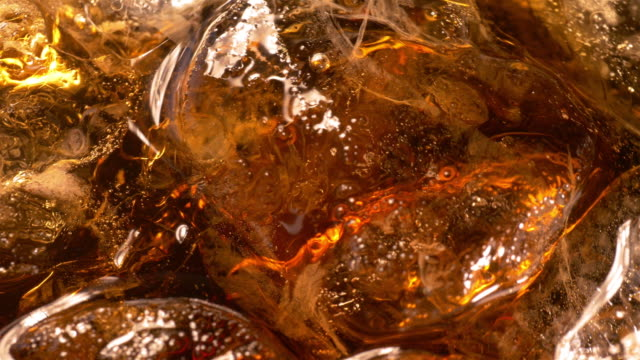 Two videos of cold drink with ice cubes in 4K
