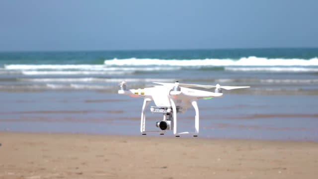 Two videos of drone flying by the ocean-real slow motion